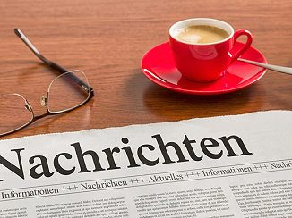Zeitung mit Nachrichten zum Thema Terror gegen Kinder